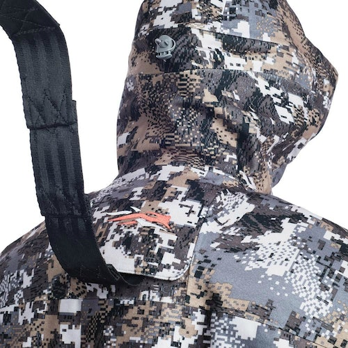 Sitka Gear has a feature on many of its whitetail jackets and parkas called a Safety Harness Pass-Through Port. It allows hunters to wear their safety harness under their outermost jacket.