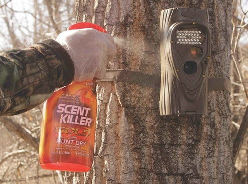 Spraying down a trail camera and being careful not to spray on the lens can eliminate your odor during placement.