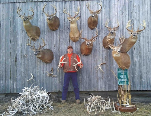 Scott Buckley proudly displays his growing collection of shoulder mounts and sheds taken from his new residence in Iowa.