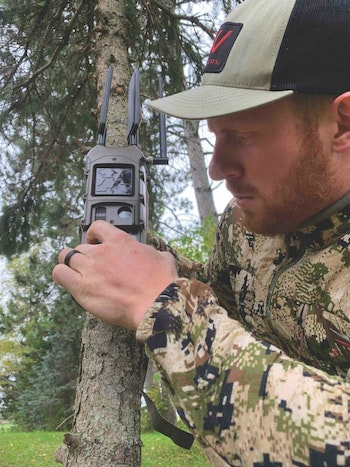 The author setting up the Cuddeback CuddeLink network for monitoring whitetail movement.