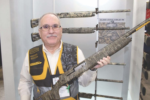 Browning representative Paul Thompson displays one of the company's popular camouflage shotgun models.