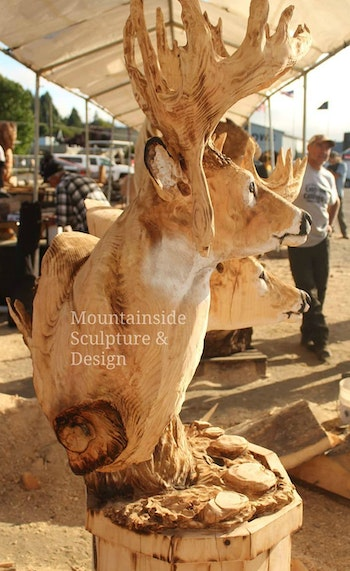 This sideview of Brandon's impressive chainsaw carving shows the level of detail in the antlers. One slip of the chainsaw and this droptine buck would quickly shed his massive antlers!