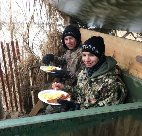 Brunch in the blind (Ty left, Elliott right), and nothing tastes as good as bacon with scrambled eggs.