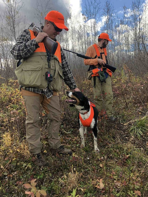 Federal's Brian Kelvington and his springer Kuzko enjoy a short timeout in the woodcock covers.