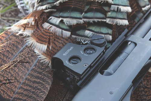 An EOTech holographic sight mounted on a shotgun excels for close-range turkeys and coyotes.