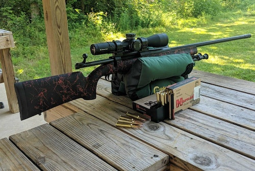 A solid bench, effective sandbags and two boxes of ammo — all important ingredients to a trouble-free sight-in session.