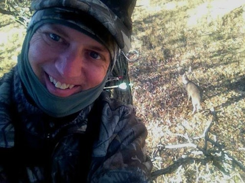 South Dakota buck selfie: The buck shown in the photo at the top of the page was so intrigued by the author's snort/wheeze call that the 4x4 wouldn't leave the area for several minutes, allowing the author to snap a bowhunter-with-buck selfie.
