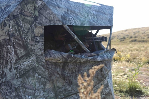 A ground blind keeps a bowhunter hidden, and it also helps contain human odor.