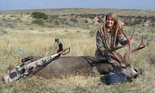 Debra Bradbury with a mature muley buck taken with a crossbow after waiting patiently in a ground blind.