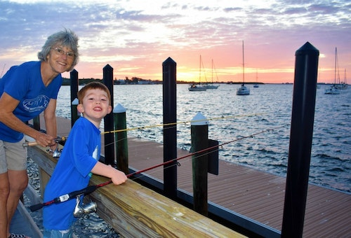 Grandma and grandson caught grouper and snapper during a sunrise fishing session on historic Bridge Street Pier at Bradenton Beach, Florida.