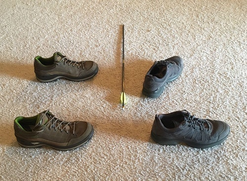 The shoes to the left are aligned sideways to the target; this is often called a square stance. The shoes to the right demonstrate an open bowhunting shooting stance.