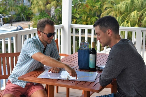Mike Kaleta (left), co-owner of Once Upon a Beach, showing the author some top fishing spots around Anna Maria Island.