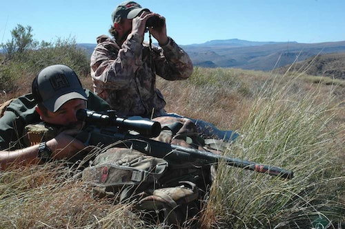 A soft pack helps this rifleman steady the rifle for a long shot. Rest the forend, never the barrel!
