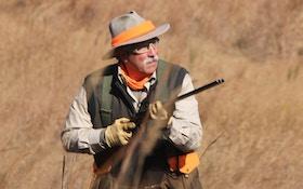 Bird Dogs Seek Instruction In Hunter's Face