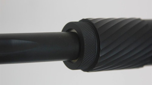 One attachment method is by screwing the suppressor directly onto the threaded end of a firearm's barrel. It's a very secure and reliable method. Photo: Silent Legion