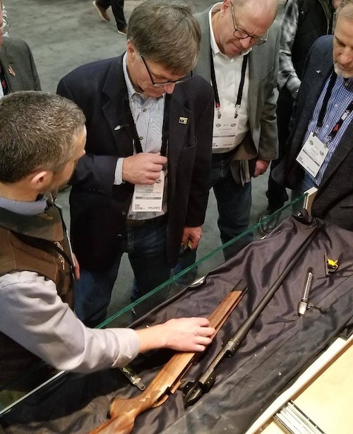 Wyoming Governor Mark Gordon talking with Adam Weatherby (left) about the Wyoming Commemorative Rifle at SHOT Show 2019.