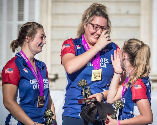 Faith Miller (center) celebrates with her Team USA compound cadet women's teammates.