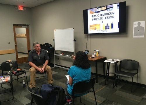 Instructor David Williams explains to Claire what he'll cover during the 2-hour basic handgun lesson.