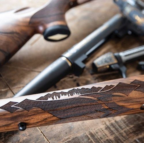 Detail stock checkering on both (Exhibition) Gold Edition & (AAA) Silver Edition Wyoming Commemorative Rifles.
