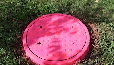 Can Pink Manhole Covers Deter Theft?