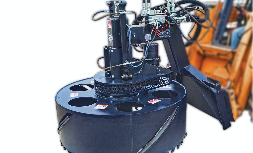 Skid-steer attachment makes manhole replacement easy