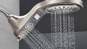 Faucets - Delta Faucet Co. HydroRain Two-in-One Shower Head