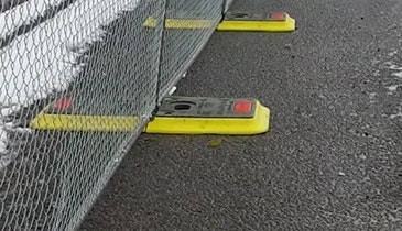 An Alternative to Sandbags for Weighting Fences