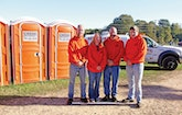 Setting Up Restrooms Along Rustic North Woods Paths