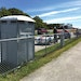 Portable restrooms keep race fans comfortable at this long track