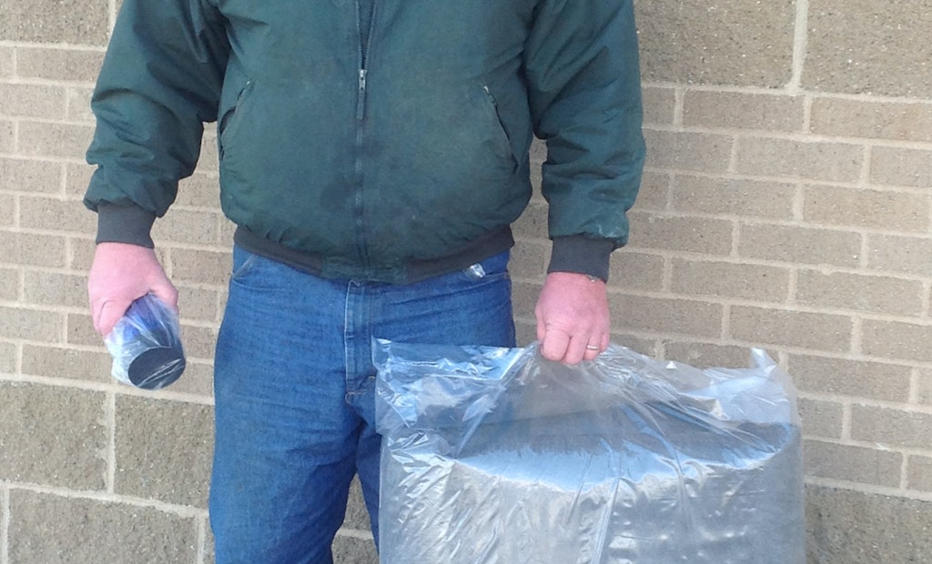 Scott Ende wins MJM septic system blanket at Expo