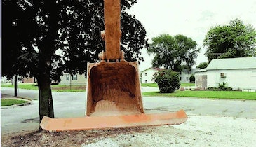 Squeegee, Crumbing Blades Reduce Backfill Time, Eliminate Bucket Teeth Marks