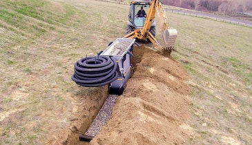 Rockslide allows one worker to install a gravel-and-pipe leach line