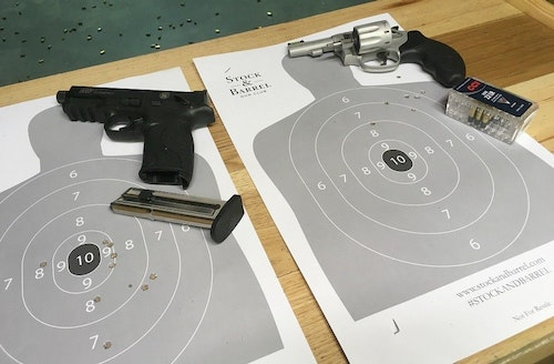 Before firing her own Glock 19 9mm semiauto, Claire spent time on the range with two handguns provided by instructor David Williams, a .22 rimfire semiauto and a .22 rimfire revolver.