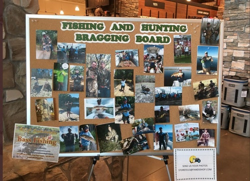 A bragging board with photos of hunters and fishermen with their favorite in-the-field harvests and catches is a popular stopping point in any outdoors store.