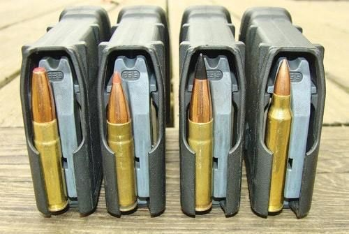Three Blackout loads (L-R): Hornady 190-grain SUB-X, Hornady 110-grain V-MAX, and Barnes 110-grain TAC-TX. The solid-copper Barnes is topped by a long plastic tip designed to approximate 5.56/.223 cartridge length (R). Note their varying magazine-ribs engagements.