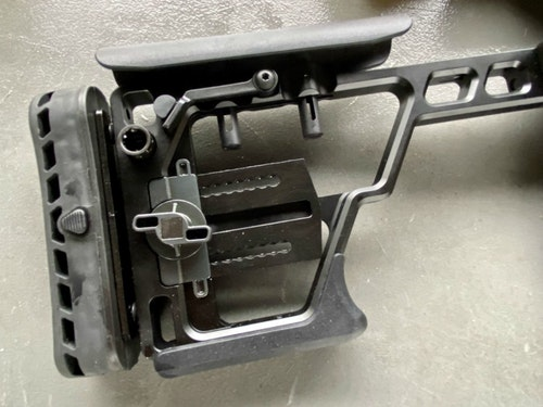The folding stock pin has been stabliized for more security. It has multiple adjustment capabilities. When folded, it keeps the bolt from being opened. (Photo: Alan Clemons)