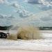 Lagoon aerator includes water cannon for foam suppression