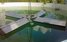 Aeration float folds for deployment through reservoir manway